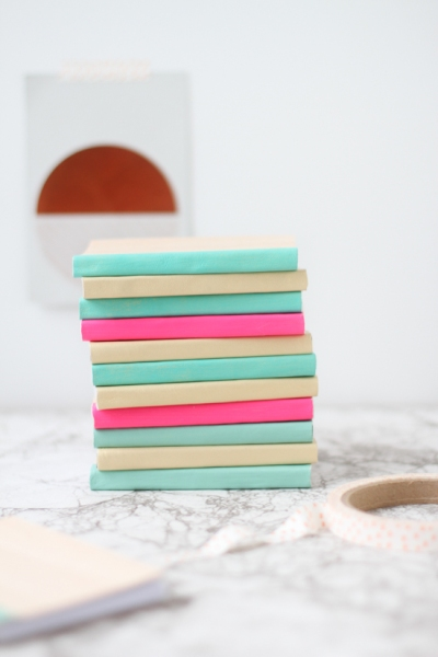 colorful-stacked-notebooks-on-marble